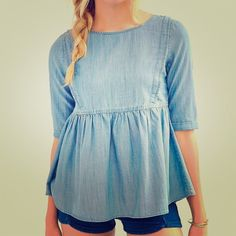 """Urban Outfitters Blue Chambray Denim Baby Doll Top Cute light blue chambray baby doll peplum blouse from Urban Outfitters, by the brand BDG. Pleating detail on front bodice. 3/4"""" sleeves. Women's size small. In great condition. Urban Outfitters Tops Blouses"""
