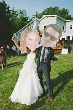Bride and Groom fun big head wedding cut outs. #bighead #weddingfun #brideandgroom http://www.weddingchicks.com/2013/11/04/family-style-wedding/