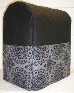 Check out this item in my Etsy shop https://www.etsy.com/listing/176235759/black-gray-quilted-medallion-damask