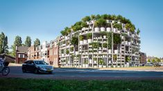 Architecture practice MVRDV has unveiled designs for Green Villa, a residential block in the Netherlands with a facade covered in a rack of potted plants. Mix Use Building, Green Building, White Building, Building Plans, Villa, Carbon Sequestration, Roof Shapes, Green Facade, Mansard Roof