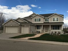 This home in Longmont has Weathered Wood shingles on it from the GAF Timberline HD line of shingles.