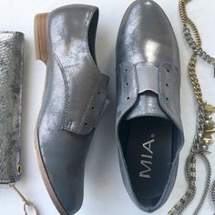 Pewter no-lace MIA Oxfords Super stylish, super comfy. Pewter metallic faux leather Oxfords. Laceless, slip-on style with an elastic gore at vamp. Caramel colored outsole and tiny heel. NWT; never worn and in original box. MIA Shoes Flats & Loafers
