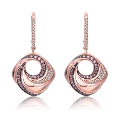 MSRP: $299.99   Our Price: $179.99   Savings: $120.00    Item Number: EAR7106(73)   Availability: Usually Ships in 5 Business Days    PRODUCT DESCRIPTION:    For a pretty and special pair of earrings these dangle earrings are perfect. It features an intricate pink swirl pattern and clear cubic zirconia stones.    FEATURES:    Sterling Silver  Brilliant Round Clear Cubic Zirconia  Brilliant Round Pink Cubic Zirconia  Unique Flower Design    PRODUCT SPECIFICATIONS:    Primary Metal Type: .925…