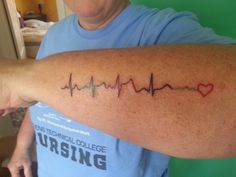 My fav ink....actual EKG beats from my husband, daughter, son, me and a representation for the little one I lost many years ago. I let the kids pick their own colors.
