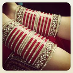 A very traditional Sikh wedding necessity - the red chuda- but worn by most Indian brides today in different colored bangles. Indian Wedding Jewelry, Indian Wedding Outfits, Indian Jewelry, Indian Bridal, Indian Bangles, Indian Weddings, Romantic Weddings, Bridal Bangles, Bridal Jewelry
