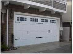 You can buy carriage hardware for garage doors for around $30. May have to do this!