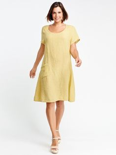 Universal Dress A loose 100% linen dress with small scoop neckline and short sleeves. Angled front patch pocket. Made from a soft marled seersucker.