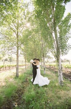 Absolutely breathtaking picture of this couple among the vines. Vineyards are a great venue for engagement and wedding photography! {Viansa Winery}