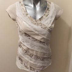 White House Black Market top Super trendy top in great used condition. Cotton shirt in a light tan color with cream trim, gold sequins and lace. Back is like cap sleeves without embellishments. White House Black Market Tops