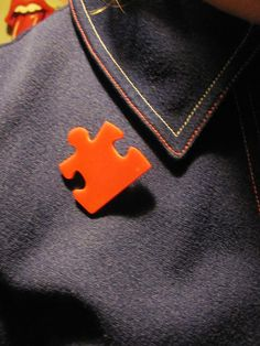 red plastic piece of puzzle