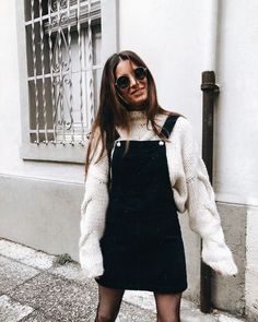 overalls and sweater