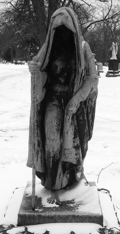 This was in the Bohemian National Cemetery the sculpture is amazing I really need this art piece in my garden.