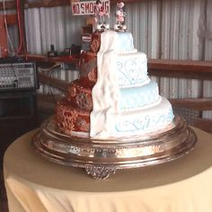 Wedding cake. Steam punk theme. Made to look like you are pulling the fondant back on the cake and revealing a machine inside!