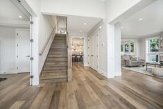 10 Plums by Wallmark Custom Homes, represents a one-of-a-kind opportunity for home buyers who are looking for a new or custom view home in North Vancouver. North Vancouver, Entrance Hall, Custom Homes, Plum, Stairs, Home Decor, Home, Entryway, Stairway
