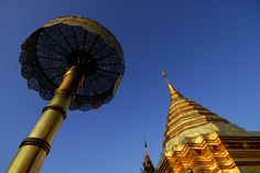Umbrella and gilded stupa spire at Wat Phra That Doi Suthep temple.~ Thailand