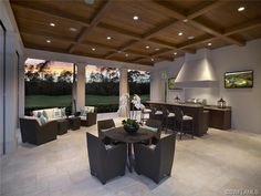 Transitional outdoor living area - summer kitchen - counter seating - golf view.  Estuary at Grey Oaks in Naples, Florida