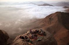 Visitors watch the sunrise from Mount Moses in the Sinai Peninsula. - REUTERS/Goran Tomasevic