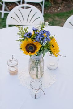 Mason jar Sunflower center piece I love the purple with the sunflower - would love to do this for law school event