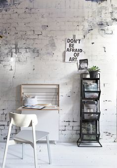 Black and white industrial room with vtwonen Factory white brick wallpaper, a white chair and desk. Accessoires by House Doctor, De Weldaad, Anno Design and Naco Trade. | Styling @Frans | Photographer Jansje Klazinga | vtwonen May 2015 | #vtwonencollectie