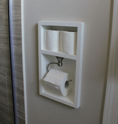 Excellent space saving idea for a small bathroom: a custom toilet paper holder built into the wall.