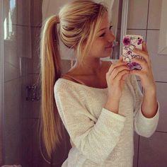 white jumper & high ponytail.