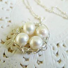 Mother bird necklace -- pearls represent children.  So cute!