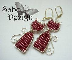 Wire wrapping handmade CAT EARRINGS. Take a look. :)