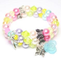 fc5fe0cc7 Spring wrap around bracelet with pastel coloured beads and butterfly and  flower charms. Diy Party