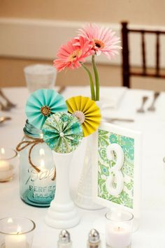 Love the craft mixed with the fresh flowers (Gerbera daisies). A great idea for a charity luncheon. Colorful and fun. #centerpiece #charity #event
