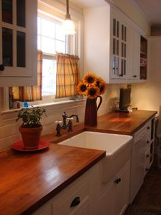 Butcher block countertops with white cabinets