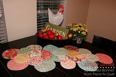 How FUN!  I think if you did EGG Shapes instead of Circles those would be a Delightful Easter or Spring Table Runner! NO quilting Required Here, either, 'n Just ''SEW SWEET!''  From the Moda Bake Shop!