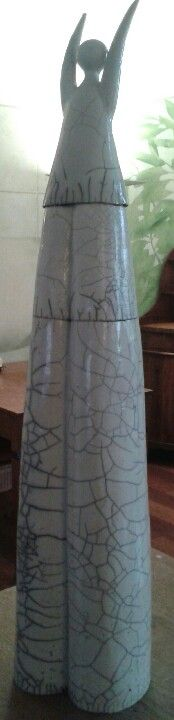 like the shape, carve in 4 family totems fill lines with black, keep ceramic natural??