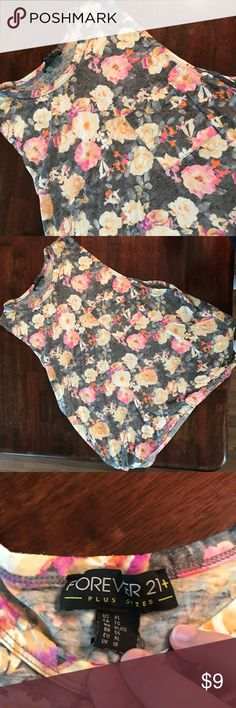 Floral Muscle Tank Gray Tank with pink and peach floral pattern. Worn, but in very good condition. No rips, stains or tears and I couldn't find any pilling or other obvious signs of wear. Forever 21 Tops Tank Tops