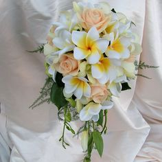 Rose Orchid Frangi Teardrop Wedding Bouquet Flowers -  Trailing bridal bouquet of Roses, Orchids and Frangipani. Support wired & treated with a polymer to ensure maximum longevity.  Frangipani colour: Variations avail incl white/yellow or pink/orange.  Foliage: Many variations are available including camellia, gardenia, magnolia, cineraria (Dusty Miller) and various ferns.