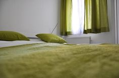 soooo beautiful green! Stylish Loggia Apartment: Hellwagstrasse, TAVienna Vienna, Curtains, Stylish, Bed, Green, Room, Furniture, Beautiful, Home Decor