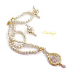American #diamond #pendent #jewellery set in #pearls buy now at  #craftshopsindia