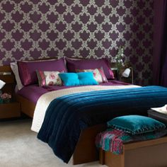 Purple master bedroom- hate the wall paper, like the rich blue and purples used