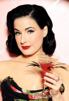Dita Von Teese Medium Wavy Cut  Dita looked absolutely breath-taking at the launch of my Private Cointreau Coffret.Her jet black waves gave her the ultimate retro-glam look.