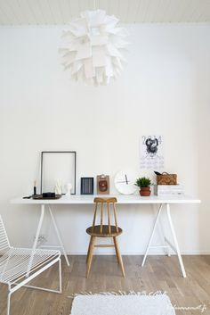 I like the white desk/table with the wood chair in this office setup. Oh, and of course, that light fixture!
