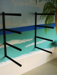 Marine grade, powder-coated aluminum SUP storage racks featuring all TIG welded construction, heavy duty foam padding with vinyl caps.