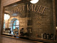 "A photo of a mirrored sign at the Doughnut Vault in Chicago, Illinois. The sign says, ""Doughnut Vault Buttermilk Old Fashioned $2.75 Gingerbread Stack $3.50 Glazed (Chestnut / Vanilla / Chocolate) $3.50 Dollar Coffee $1.""Learn more about this tiny ""hole"" in the wall donut shop by reading the FoodWaterShoes article, ""They're Coming to Take Me Away, Ha Ha! – Doughnut Vault in Chicago, Illinois"" - Food Foodie Foodies FoodPorn Snacks Food Shop Eat Restaurants Local Eats Eating Fried Food…"