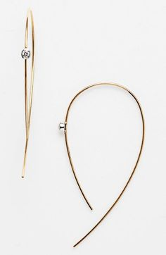 Free shipping and returns on Lana Jewelry 'Spellbound - Hooked on Hoops' Diamond Hoop Earrings at Nordstrom.com. Two sparkling diamonds beam from these modernized hoop earrings designed with slender gold wires that delicately thread the ear.