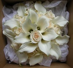 Rose And Lily Bridal Bouquet | touch of sparkle for the bride and masses of roses and petals for ...
