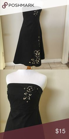 Black strapless dress EXPRESS size 4 black strapless dress. Side zipper with floral cut out embleshment on bodice and skirt Express Dresses Midi