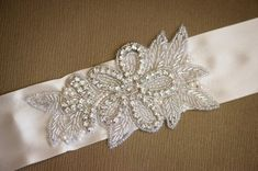 Rhinestone Bridal Sash, Crystal and Rhinestone Bridal Sash, Rhinestone Wedding Belt, Rhinestone Bridal Belt.      Ready to Ship (3-5 days)    The size of this piece is approximately 5 inches wide by 3 inches tall.  This bridal sash is shipped with 3 yards of your choice of double faced satin ribbon.    You can also request custom colors or design elements, please just convo me with your dream colors.    I specialize in custom orders, especially for weddings, and enjoy doing them. Please just…