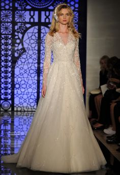 Reem Acra Fall 2016 embroidered, long-sleeved gown with a V-neck and tulle skirt | https://www.theknot.com/content/reem-acra-wedding-dresses-bridal-fashion-week-fall-2016
