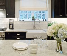 Love the dark cabinets and white countertop/backsplash.