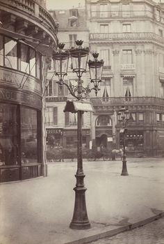 The elegant gas lamps of Paris' Haussmann transformation, seen here in 1877-1878, contributed to its reputation as a modern metropolis....