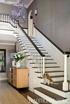 Dark stained wood on the stairs paired with crisp white trim makes a striking first impression. - Photo: Michael Garland / Design: Heidi Bonesteel and Michele Trout Entry Stairs, Entry Hallway, House Stairs, Entryway, Design Entrée, Design Firms, House Design, Interior Design, Villa Plan