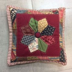 This small patchwork cushion has been beautifully handcrafted. It measures 28cm x 28cm and weighs 100gms. (Please note we will ship internationally, contact us for a quote).